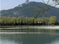 View over Kunming Lake towards Yu Quan Hill with Yu Feng Pagoda.