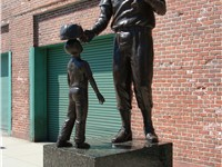 Sculpture of Ted Williams outside Fenway Park.