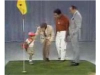 Woods (age 2) on The Mike Douglas Show. From left, Tiger Woods, Mike Douglas, Earl Woods and Bob Hop