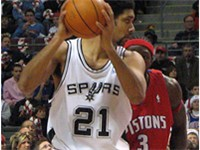 Duncan backs down Ben Wallace (then of the Pistons) in a 2005 game.