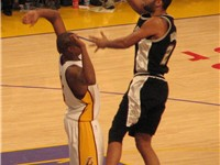 Duncan going up for a shot over the Lakers' Andrew Bynum