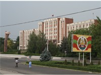Transnistria parliament building in Tiraspol. In front is a statue of Lenin.