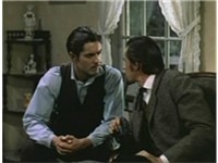 Jesse James, played by Tyrone Power, listens to Bob Ford, played by John Carradine, in a scene from