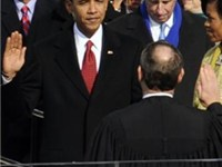 Barack Obama taking the presidential oath of office from U.S. Chief Justice John G. Roberts, January