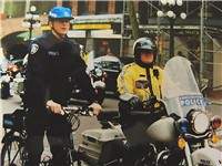 Vancouver police officers from the bicycle and motorcycle squads, on the streets of Gastown