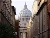 View of the dome of Saint Peter's Basilica from a nearby street.