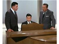 "(Left to right) Robert B. Sherman, Richard M. Sherman and Walt Disney sing ""There's a Great Big Beau"