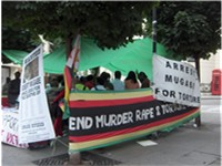 Protesters against the Mugabe regime abroad; protests are discouraged by Zimbabwean police in Zimbab