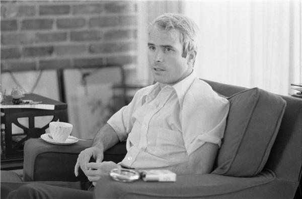 john mccain vietnam. McCain giving an interview to